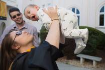 Nicole Alteri-Synan, a Master of Science in Psychology candidate, holds her son Dante Synan in the air after the Brenau University College of Health Sciences Graduate Hooding Ceremony on Thursday, May 5, 2016. (AJ Reynolds/Brenau University)