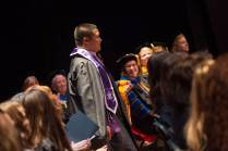 Frank Quinto, a Master of Science in Nursing candidate, walks forward to receive and award during the Brenau University College of Health Sciences Graduate Hooding Ceremony on Thursday, May 5, 2016. (AJ Reynolds/Brenau University)