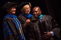 Dr. Allen Patmon is hooded for an Occupational Therapy Doctorate by Gale Starich, dean of the College of Health Sciences, and Barbara Schell, associate dean of the College of Health Sciences, during the Brenau University College of Health Sciences Graduate Hooding Ceremony on Thursday, May 5, 2016. (AJ Reynolds/Brenau University)