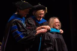 Dr. Sara Propes is hooded for an Occupational Therapy Doctorate by Gale Starich, dean of the College of Health Sciences, and Barbara Schell, associate dean of the College of Health Sciences, during the Brenau University College of Health Sciences Graduate Hooding Ceremony on Thursday, May 5, 2016. (AJ Reynolds/Brenau University)