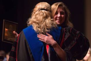 Elizabeth Huff gets a hug from Dina Hewett after receiving the Ocie Rich Pope Award during the Brenau University School of Nursing Pinning Ceremony on Thursday, May 5, 2016 in Pearce Auditorium in Gainesville, Ga. (AJ Reynolds/Brenau University)