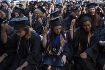 Graduates move their tassels after receiving their degrees during The Women's College Commencement on Friday, May 6, 2016, in Gainesville, Ga. (AJ Reynolds/Brenau University)