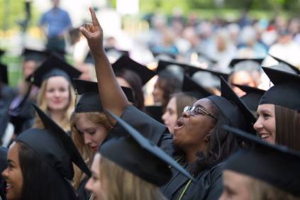 Dana Cole, WC '16, center, cheers as degrees are conferred during The Women's College Commencement on Friday, May 6, 2016, in Gainesville, Ga. (AJ Reynolds/Brenau University)