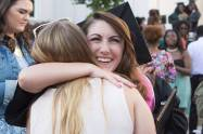 Lauren LaRicci, WC '16, gets a hug after The Women's College commencement on Friday, May 6, 2016, in Gainesville, Ga. (AJ Reynolds/Brenau University)