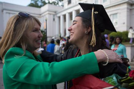 Women's College Dean Debra Dobkins, right hugs Tahimi Perez-Borroto, WC '16, after The Women's College commencement on Friday, May 6, 2016, in Gainesville, Ga. (AJ Reynolds/Brenau University)