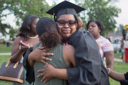Quanesha Davis, WC '16, sheds a tear while getting a hug from Trae Candelario after The Women's College commencement on Friday, May 6, 2016, in Gainesville, Ga. (AJ Reynolds/Brenau University)