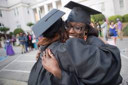 Aisha Ndiaya hugs Quanesha Davis, both WC '16, after The Women's College commencement on Friday, May 6, 2016, in Gainesville, Ga. (AJ Reynolds/Brenau University)