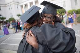 Aisha Ndiaya hugs Quanesha Davis, both WC '16, after The Women's College commencement on Friday, May 6, 2016, in Gainesville, Ga. (AJ Reynolds/Brenau University)