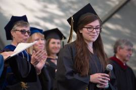 Rachel McFarland, WC '16, walks off stage after singing the National Anthem during The Women's College commencement on Friday, May 6, 2016, in Gainesville, Ga. (AJ Reynolds/Brenau University)