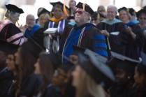 Stewart Blakley walks to the stage to accept the Vulcan Teaching Award during The Women's College commencement on Friday, May 6, 2016, in Gainesville, Ga. (AJ Reynolds/Brenau University)