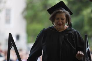 Alecia Webb walks to the stage to accept one of two Outstanding Part-Time Faculty Awards during The Women's College commencement on Friday, May 6, 2016, in Gainesville, Ga. (AJ Reynolds/Brenau University)