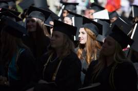 Alaina Troha, WC '16, and other graduates listen during The Women's College commencement on Friday, May 6, 2016, in Gainesville, Ga. (AJ Reynolds/Brenau University)