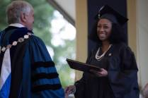 Cheyenne Candelario, WC '16, receives her Bachelor of Science in Nursing for Brenau President Ed Schrader during The Women's College commencement on Friday, May 6, 2016, in Gainesville, Ga. (AJ Reynolds/Brenau University)