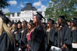 Graduates place their hands on their hears during the singing of the National Anthem during The Women's College commencement on Friday, May 6, 2016, in Gainesville, Ga. (AJ Reynolds/Brenau University)