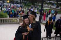 Emily Lemons and Brittany Daniel, both WC '16, hug during The Women's College commencement on Friday, May 6, 2016, in Gainesville, Ga. (AJ Reynolds/Brenau University)