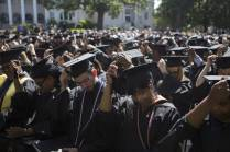Denise Fields, who received a Masters in Business Administration degree in marketing, and other graduates turn their tassels during the Brenau University Undergraduate and Graduate Commencement on Saturday, May 7, 2016, in Gainesville, Ga. (AJ Reynolds/Brenau University)