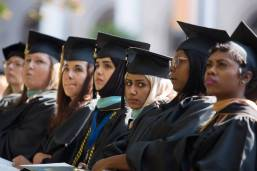 Ashjan Alyamani, a candidate for a Masters of Education degree, third from right, and other graduates listen to the commencement address during the Brenau University Undergraduate and Graduate Commencement on Saturday, May 7, 2016, in Gainesville, Ga. (AJ Reynolds/Brenau University)