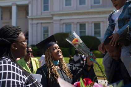Kia Howell, an early childhood education masters graduate, gets a bouquet of flowers after the Brenau University Undergraduate and Graduate Commencement on Saturday, May 7, 2016, in Gainesville, Ga. (AJ Reynolds/Brenau University)