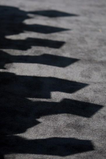 Graduates cast shadows during the Brenau University Undergraduate and Graduate Commencement on Saturday, May 7, 2016, in Gainesville, Ga. (AJ Reynolds/Brenau University)