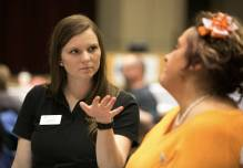 Brenau University occupational therapy graduate student Callie Setzer, left, asks a question of Spencer Wix, wife of former Shepherd Center patient Toy Wix. (Phil Skinner for Brenau University)