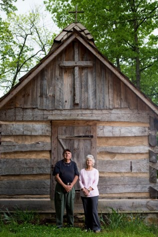Joyce Lott, WC '59, right, and her husband Tom Lott pose for a photo in front of the church at the village on their farm on Tuesday, May 3, 2016, in Cleveland, Ga. (AJ Reynolds/Brenau University)