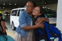 Daisy Qiu get a hug from Dr. Crystal Toombs, associate provost for adult and graduate studies, before boarding a bus to leave the airport. (AJ Reynolds/Brenau University)