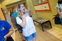 Erin Henderson, one of Brenau's student ambassadors, who recently travelled to China, reacts as she is reconnected with her classmates for the first time. (AJ Reynolds/Brenau University)