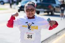 Arianna Escobedo poses for a photo while running during the Dempsey Dash 5K, a race celebrating the memory of Brenau's longtime Executive Vice President and CFO Wayne Dempsey, on Saturday, March 11, 2017. (AJ Reynolds/Brenau University)