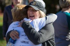 Nita Tammarine gets a hug from Danielle Miller, right, after finishing the Dempsey Dash 5K, a race celebrating the memory of Brenau's longtime Executive Vice President and CFO Wayne Dempsey, on Saturday, March 11, 2017. (AJ Reynolds/Brenau University)