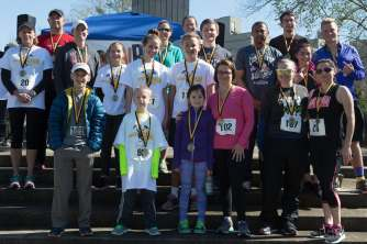 Participants pose for a photo after the Dempsey Dash 5K, a race celebrating the memory of Brenau's longtime Executive Vice President and CFO Wayne Dempsey, on Saturday, March 11, 2017. (AJ Reynolds/Brenau University)