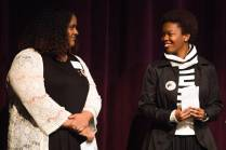 Sara Hubaishi, left, and Simone Lewis give a pair of welcomes for the 4th Annual Women's Leadership Colloquium on Friday, March 17, 2017. (AJ Reynolds/Brenau University)