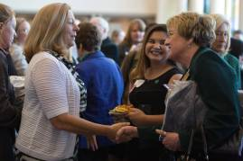Patricia Wolfe, left, shakes hands with Gale Starich, dean of the College of Health Sciences, during the 4th Annual Women's Leadership Colloquium on Friday, March 17, 2017. (AJ Reynolds/Brenau University)