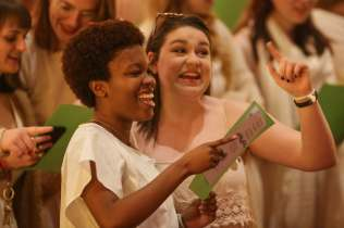 Juniors Simone Lewis and Mary Virginia Mitchell sing to the graduating seniors during the 2017 Alumnae Reunion Weekend at Brenau University, Saturday, April 08, 2017. (Photo/ John Roark for Brenau University)