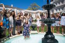 Savannah Romans and her Phi Mu sisters celebrate her engagement after she was thrown into the Grace Hooten Moore Memorial Fountain. (AJ Reynolds/Brenau University)
