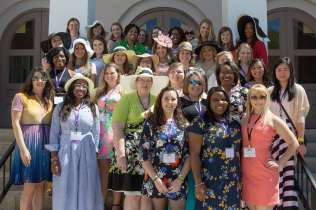 Alumnae from the 2010s pose for a photo on the Bailey Hall steps for May Day. (AJ Reynolds/Brenau University)