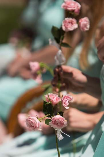 May Court members hold roses as they take their seats. (AJ Reynolds/Brenau University)