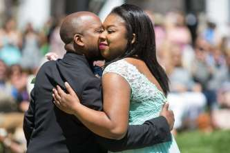 Quonna Holden gets a hug from her father, Demond Smith during May Day. (AJ Reynolds/Brenau University)