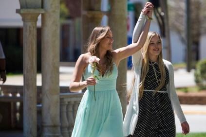 Pam Konken (left) is escorted by her sister Hillary Konken. (AJ Reynolds/Brenau University)