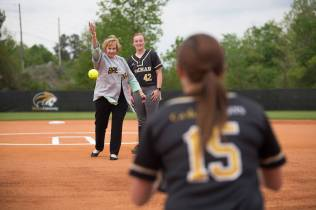 Kay Ivester throws out the ceremonial first pitch before a doubleheader between Brenau and Faulkner University. The ceremonial first pitch concluded a celebration of the first year of Brenau softball games at the Ernest Ledford Grindle Athletics Park. (AJ Reynolds/Brenau University)