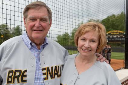 Doug and Kay Ivester pose for a photo at the Pacolet Milliken Field in the Ernest Ledford Grindle Athletics Park. The park is named for Kay's Father. (AJ Reynolds/Brenau University)