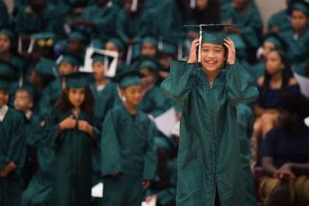 Itzel Islas smiles while she walks to receive her diploma during the commencement ceremony for the RISE Program on Friday, July 14, 2017 at Fair Street School. (AJ Reynolds/Brenau University)