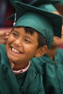 Julio Chavez smiles during the commencement ceremony for the RISE Program on Friday, July 14, 2017 at Fair Street School. (AJ Reynolds/Brenau University)