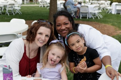 Eliza Thornton, WC '04, Shena Gazaway, WC '05 & BU '09, pose for a photo with their daugthers Claire Thornton and Brianna Gazaway during Alumnae Reunion Weekend on Friday, April 13, 2018. (AJ Reynolds/Brenau University)