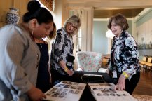 Marcia Meliski Stoke, WC '68, and Lynne Serge Doby look at their yearbooks with Emma Light and Bianca Orr during Alumnae Reunion Weekend on Friday, April 13, 2018. (AJ Reynolds/Brenau University)