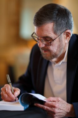 Jim Southerland signs copies of Sharecropper's Son (AJ Reynolds/Brenau University)