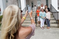 Academy alums take photos of each other during the celebration of the 90th anniversary of the Academy. (AJ Reynolds/Brenau University)
