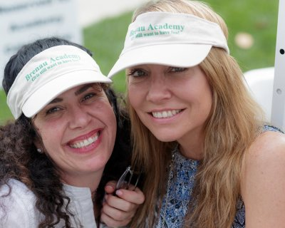 Beth Morrison and Karen Hansen Landen don 'Girls Still Want to Have Fun' visors at the Academy 90th anniversary celebration. (AJ Reynolds/Brenau University)