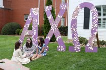 From left to right; Annie Fox, Sarah Rooker, and Anahyne Aniceto talk outside of the Alpha Chi Omega house during sorority open house of the Alumnae Reunion Weekend & May Day at Brenau University Saturday, April 14, 2018, in Gainesville, Ga. Photo by Jason Getz / Brenau University