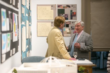 Brenau President Ed Schrader, right, talks with a guest during the Interior Design Retrospective at the Burd Center for the Performing Arts at Brenau University Saturday, April 14, 2018, in Gainesville, Ga. Photo by Jason Getz / Brenau University