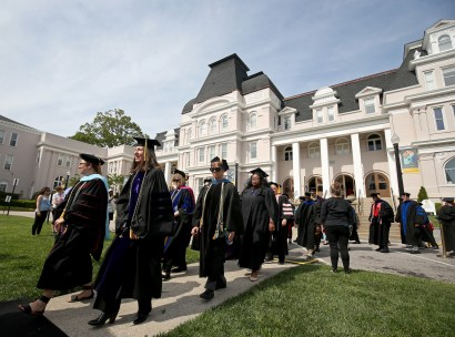 The faculty leads the processional to start the Women's College Commencement at Brenau University Friday May 4, 2018 in Gainesville, Ga. (Jason Getz for Brenau University)